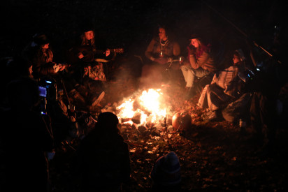 Cast and crew shooting campfire